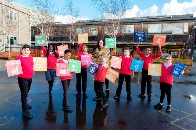 Children holding SDG cubes